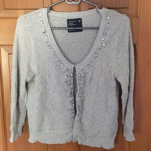 Gray knit cardigan with clasps up the front